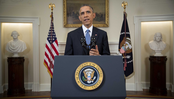 TOPSHOTS President Barack Obama delivers an address to the nation from the Cabinet Room of the White House, on December 17, 2014. Obama spoke about the ralease earlier December 17 of Alan Gross, who spent five years in a Cuban prison.  AFP PHOTO / POOL / DOUG MILLS